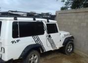 Vendo excelente jeep wrangle con el motor dañado