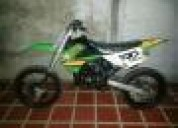 Vendo excelente moto cross kx80 2004