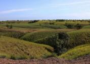Lote de terreno, dos potreros, laguna y quebradas