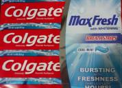 Crema de dientes colgate de 215 gramos.
